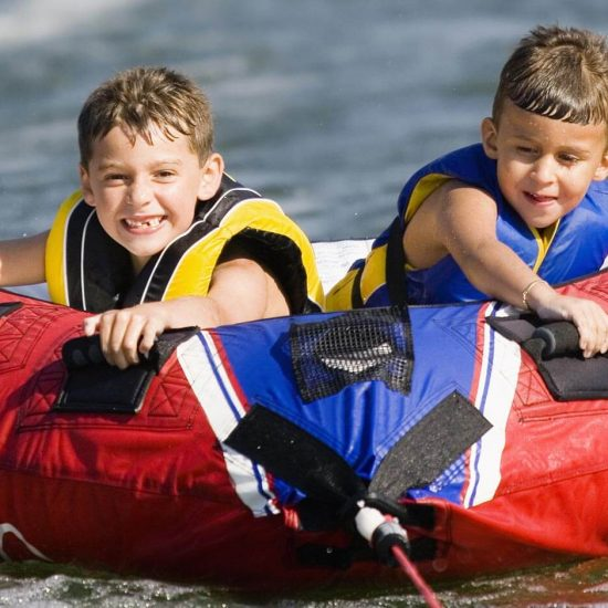 two-kids-tubing-on-the-water-550x550
